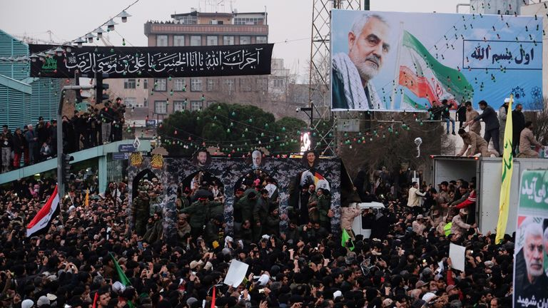 Thousands gather around a vehicle carrying the coffin of Qassem Soleimani