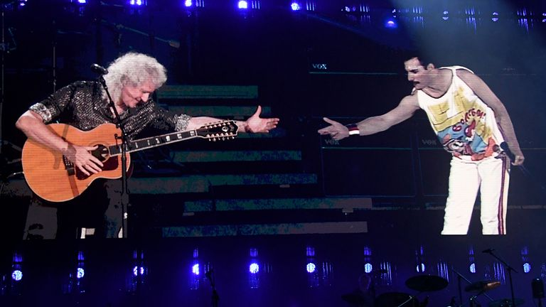 Brian May of Queen performs on stage with Freddie Mercury on screen during the 2019 Global Citizen Festival: Power The Movement in Central Park on September 28, 2019 in New York City
