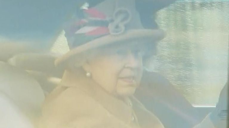 The Queen looks out of car window at Sandringham crowd