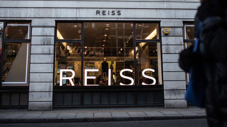 LONDON, ENGLAND - FEBRUARY 15:  A woman walks past a Reiss store on February 15, 2016 in London, England. Investment firm Warburg Pincus, which owns 15 per cent of discount chain Poundland, has expressed an interest following an announcement by company owner David Reiss that he intends to sell a stake in his company.  (Photo by Carl Court/Getty Images)