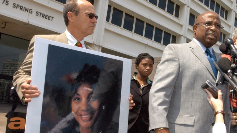 John Hawthorne, right, widower of Alice Hawthorne, the woman killed in the 27 July 1996 Centennial Olympic Park explosion, speaks after Eric Rudolph was sentenced to life in prison for three Atlanta bombings. Alice Hawthorne's daughter is to the left of Hawthorne