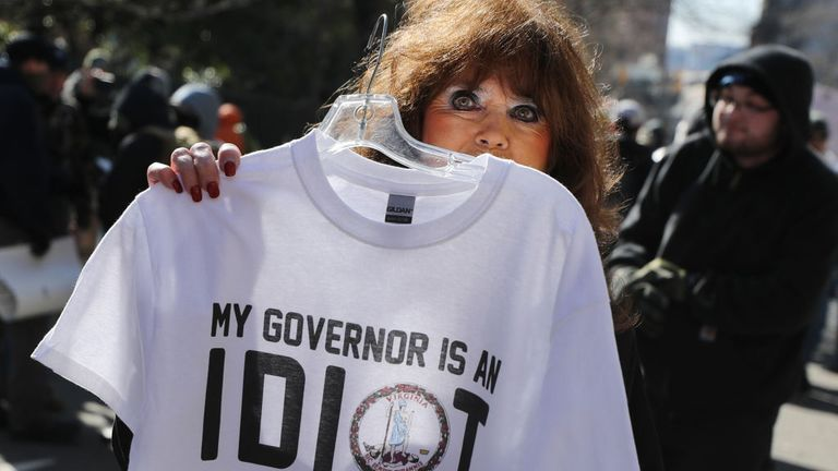 A vendor sells t-shirts on the street outside a gun rights rally organized by The Virginia Citizens Defense League