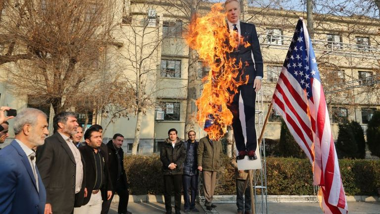 Cardboard cutout of Britain's ambassador Rob Macaire burned in Tehran