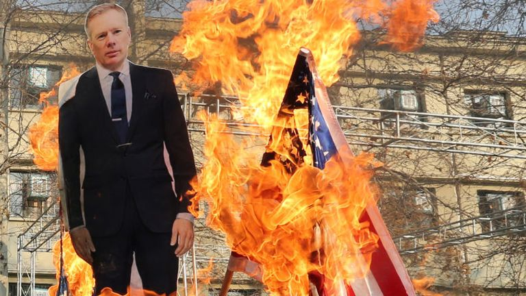 A cardboard cutout of Britain's ambassador Rob Macaire is burned in Tehran