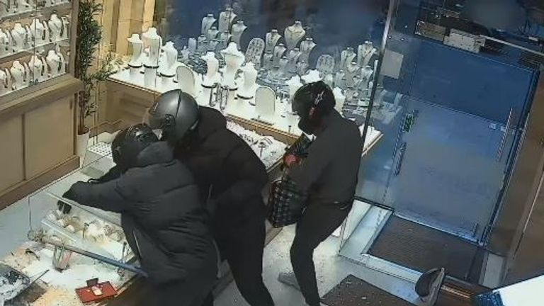The three robbers smashed glass cases and grabbed jewellery from them