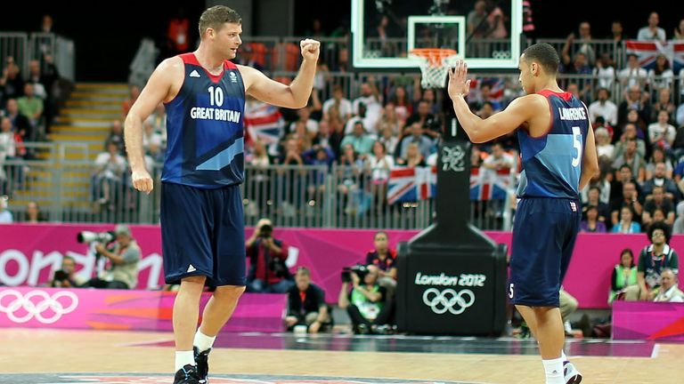 Robert Archibald #10 of Great Britain and teammate Andrew Lawrence #5 celebrates after drawing a foul against Spain in in the second half during the Men's Basketball Preliminary Round match on Day 6 of the London 2012 Olympic Games at Basketball Arena on August 2, 2012 in London