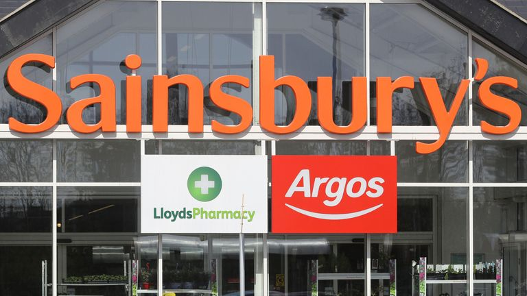 General view of the entrance to a Sainsbury's supermarket, incorporating a Lloyds Pharmacy and an Argos store, in Whitley Bay, North Tyneside