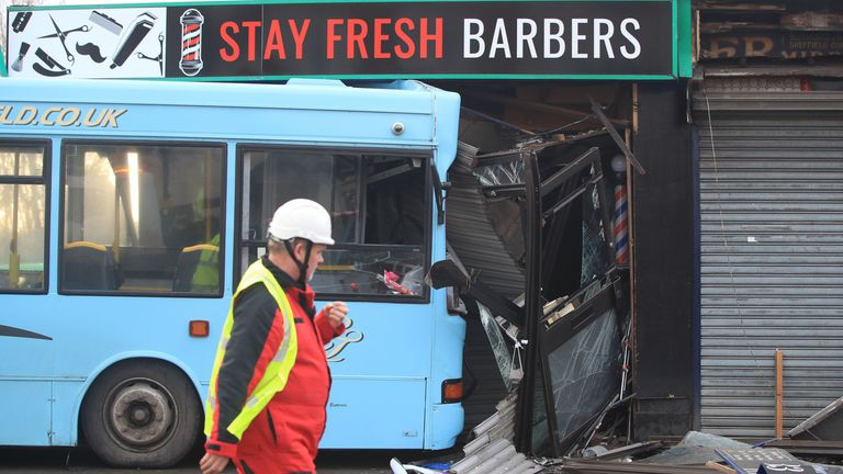 The scene in Handsworth Road, Sheffield, where a school bus crashed into the front of a barbers shop