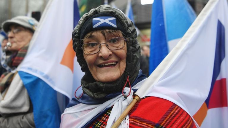 A pro-independence protester gestures as she joins a march organised by the grassroots organistaion All Under One Banner calling for Scottish independence in Glasgow on January 11, 2020. - Thousands of independence supporters are expected the march through the streets of Glasgow, despite a rally that was planned to conclude the event being cancelled after Met Office warnings of high winds. (Photo by ANDY BUCHANAN / AFP) (Photo by ANDY BUCHANAN/AFP via Getty Images)