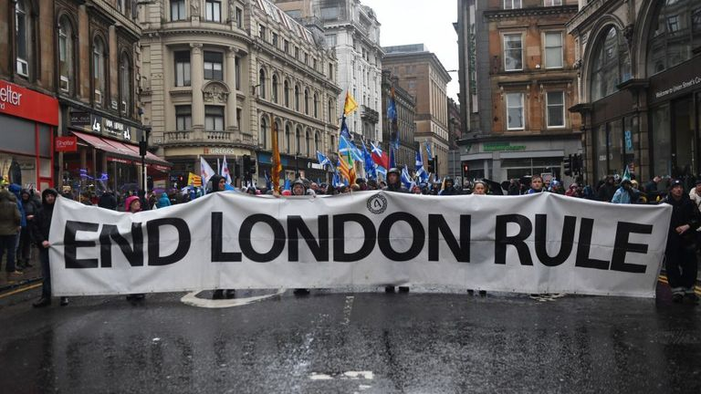 'End London Rule' written a street-wide banner being carried by demonstrators