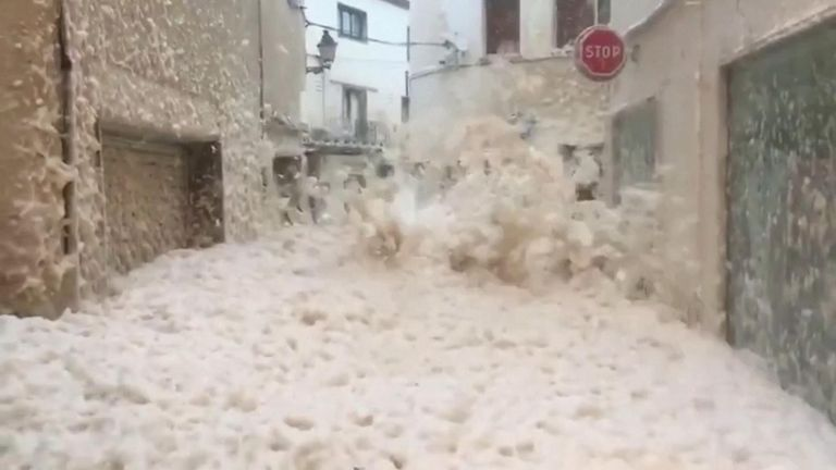 The foam, caused by the agitation of organic matter in seawater, stuck to the walls of buildings as it engulfed the coastal town.