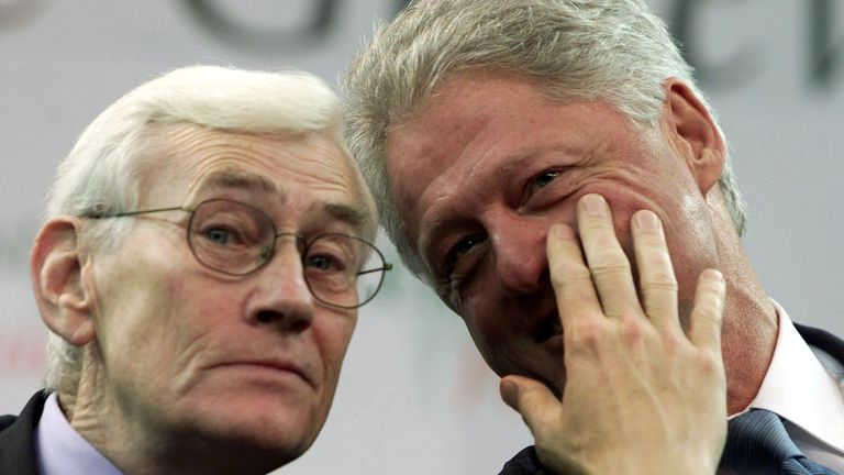FILE PHOTO: U.S. President Bill Clinton talks with Deputy First Minister Seamus Mallon (L) at the Odyssey Centre in Belfast during Clinton's visit to Northern Ireland December 13, 2000./File Photo