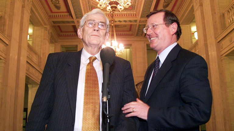Northern Ireland's First Minister David Trimble (R) and Deputy First Minister Seamus Mallon (L) address the media 02 December 1999, in the Great Hall of the Parliament Buildings in Stormont in Belfast, following the first meeting of the new first-ever power-sharing executive of Northern Ireland. (ELECTRONIC IMAGE) (Photo credit should read ADRIAN DENNIS/AFP via Getty Images)