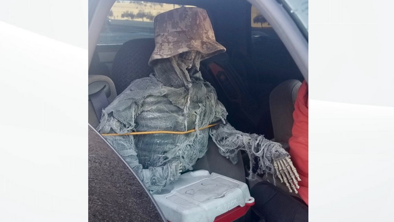 Police stopped a man using a skeleton as a passenger. Pic: Arizona Department of Public Safety