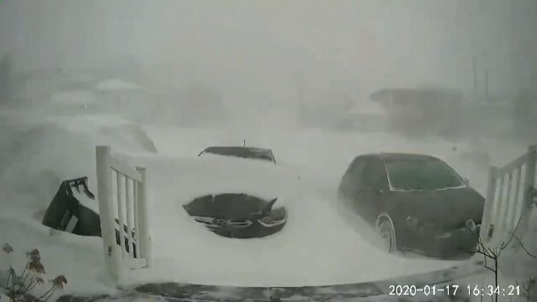 Timelapse video shows snowfall burying vehicles between approximately 3 pm to around 6 am local time.
