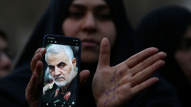 An Iranian woman shows a photo of the late Iranian Major-General Qassem Soleimani, during a protest against the assassination of Soleimani, head of the elite Quds Force, and Iraqi militia commander Abu Mahdi al-Muhandis, who were killed in an air strike at Baghdad airport, in front of United Nation office in Tehran, Iran January 3, 2020