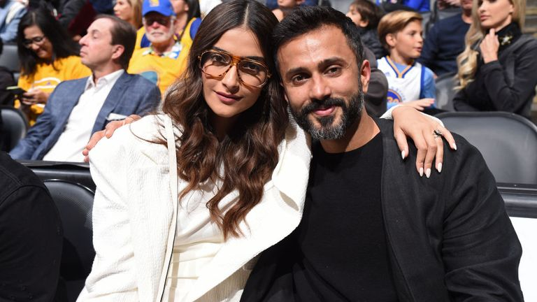 Sonam splits her time between India and London where she and her husband, Anand Ahuja (r) have a house