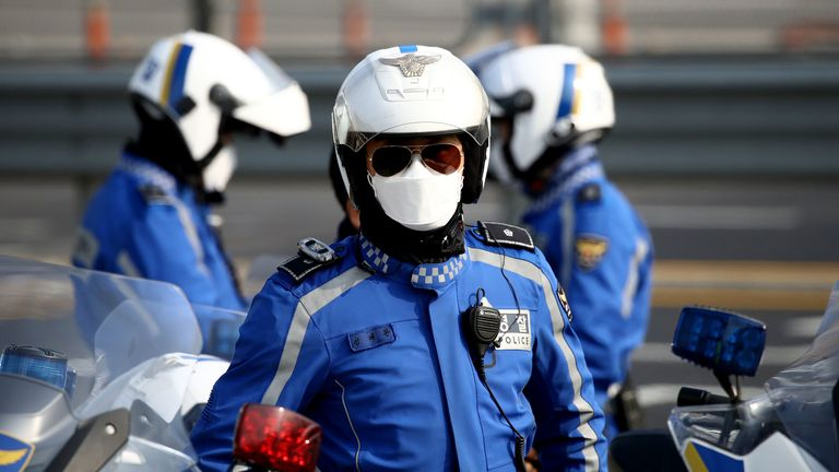 A South Korean police officer has his face covered in the capital Seoul