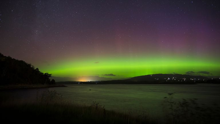 "The Aurora Australis, or ""Southern Lights"" light up over the Mersey River in Devonport on March 27, 2017 in Devonport,  Tasmania, Australia. Aurora Australis, also known as the Southern Lights, happens when the sun releases a massive burst of solar wind and magnetic fields into space. These solar winds carry particles which interact with earth's magnetic field, colliding to produce energy releases in the form of auroras"