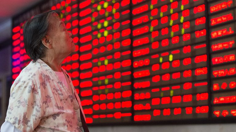 An investor observes electric screen at a stock exchange hall on August 4, 2015 in Nanjing, Jiangsu Province of China