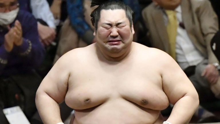 Tokushoryu cries after beating ozeki Takakeisho at the New Year Grand Sumo Tournament in Tokyo