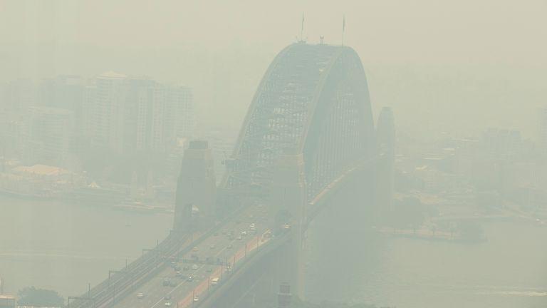 A view of the Sydney Harbour Bridge shrouded in smoke on December 19, 2019 in Sydney, Australia