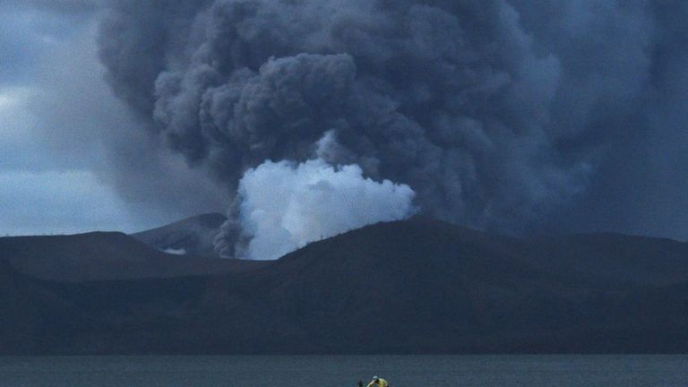 Residents living along Taal lake catch fish as Taal volcano erupts in Tanauan town