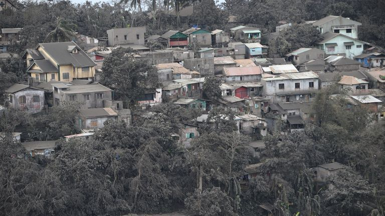 A general view of houses with roofs covered with ash, spewed by Taal volcano in Tagaytay city, south of Manila