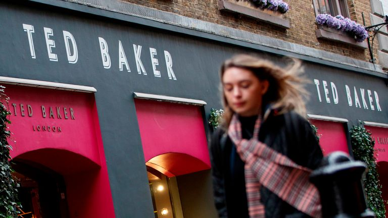 Pedestrians walk past a Ted Baker clothing store in London on December 10, 2019