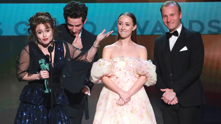 Crown stars (L-R) Helena Bonham Carter, Josh O'Connor and Erin Doherty accept the award
