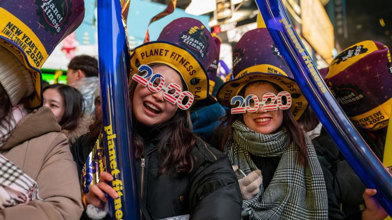 Revelers at Times Square during the New Year's Eve celebration on December 31, 2019 in New York City