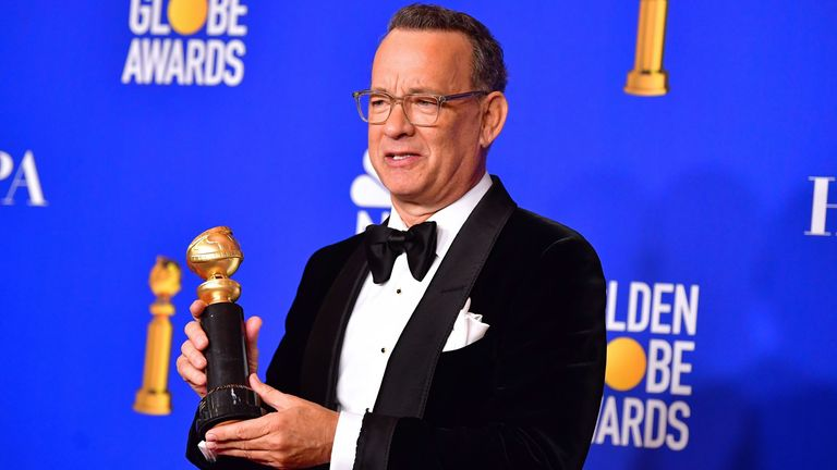 Golden Globes winner Tom Hanks with the  Cecil B Demille lifetime achievement award