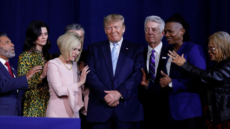 President Donald Trump participates in a prayer before speaking at an Evangelicals for Trump Coalition Launch at the King Jesus International Ministry in Miami, Florida, U.S