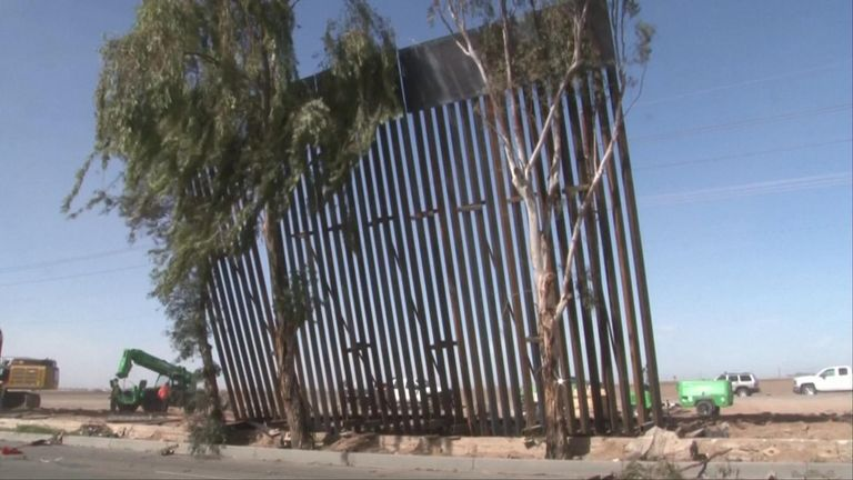 A section of the wall the US government is building on its border with Mexico blew over due to high winds according to local media.