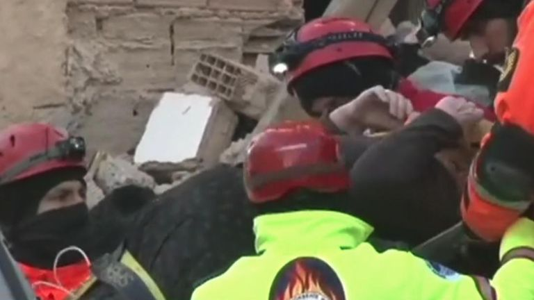 Moment pregnant woman rescued from rubble