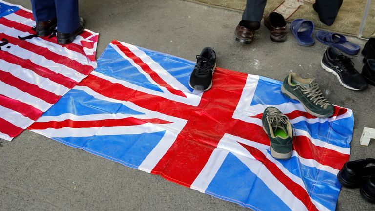 Shoes are placed on a UK flag at a Tehran university Pic: Shutterstock