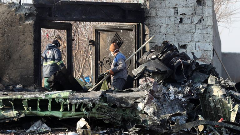 Rescue teams work amidst debris after a Ukrainian plane carrying 176 passengers crashed near Imam Khomeini airport