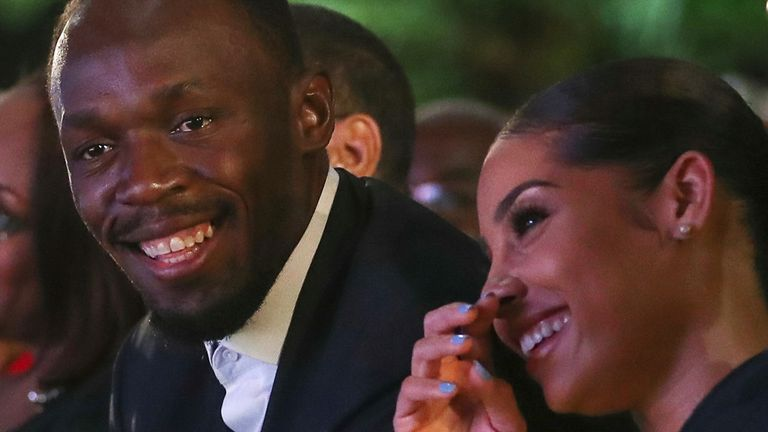 Olympic champion Bolt and his girlfriend Kasi Bennett attend a ceremony for the unveiling of Bolt's statue at the Statue Park at the National Stadium, in Kingston, Jamaica December 3, 2017