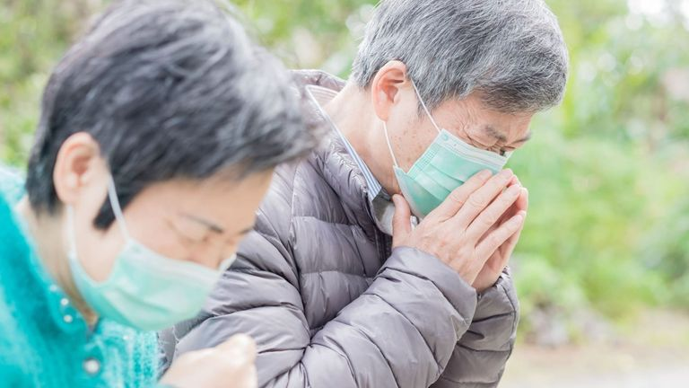 Couple wears masks to protect from mystery virus in China