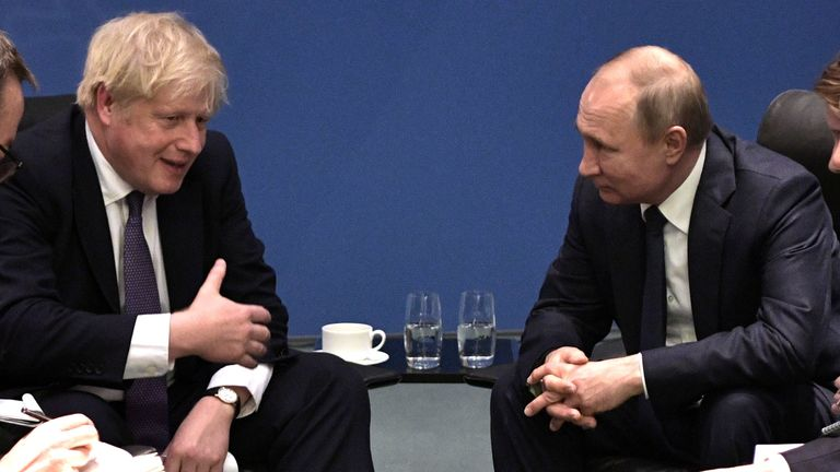 Russia's President Vladimir Putin and Britain's Prime Minister Boris Johnson meet on sideline of the Libya summit in Berlin, Germany January 19, 2020