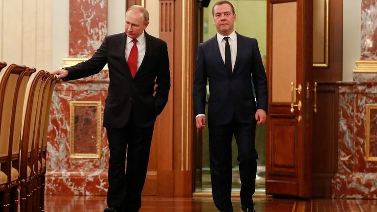Vladimir Putin (L) has asked Dmitry Medvedev to keep working until the new cabinet is formed