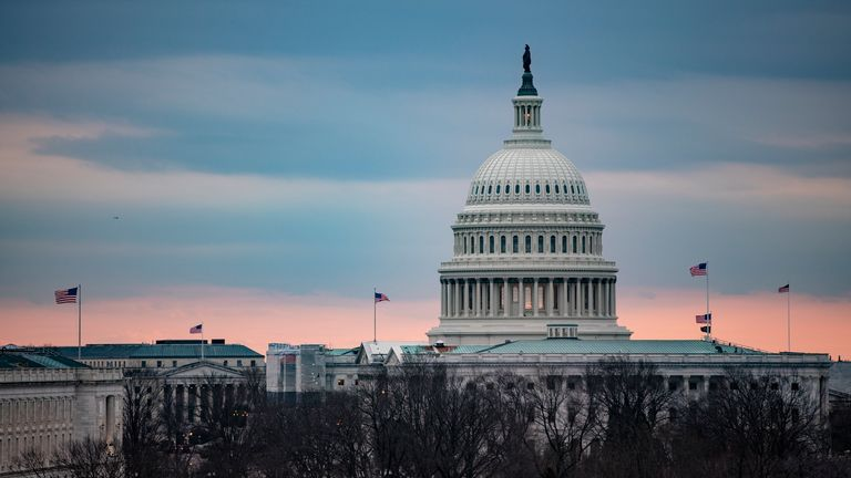 WASHINGTON, DC - JANUARY 27: The sun sets over the US Capitol during the Senate impeachment trial of President Donald Trump on January 27, 2020 in Washington, DC. The defense team continues its arguments on day six of the trial of President Trump. (Photo by Samuel Corum/Getty Images)
