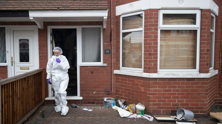 A forensics officer at the scene of the fire