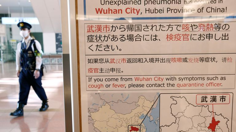 Signs at Tokyo's Haneda airport told passengers who had been to Wuhan to make themselves known