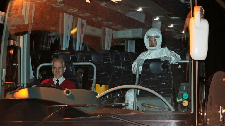 A medic wearing a white specialist suit was sat next to the coach driver of each vehicle