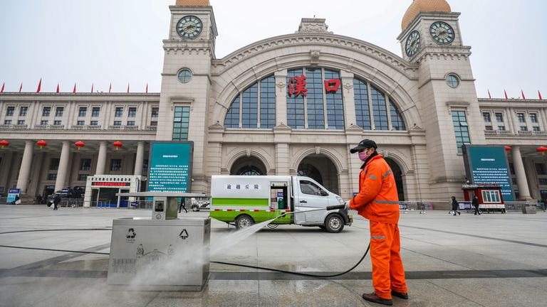 A worker sanitizes the square in front of the Hankou Railway Station, closed after the city of Wuhan was locked down