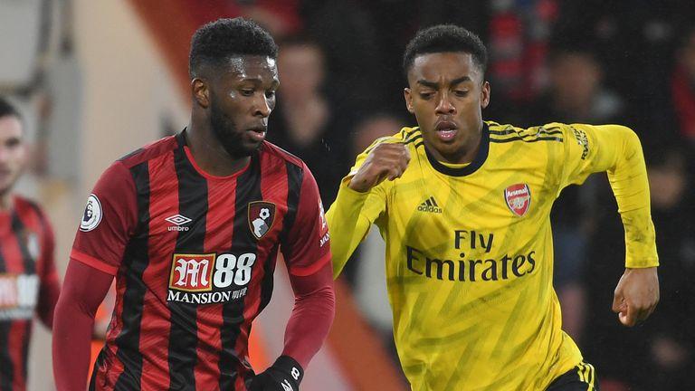 Joe Willock challenges Jefferson Lerma during the Premier League encounter