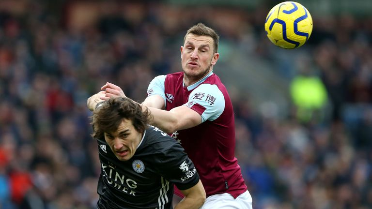 BURNLEY, ENGLAND - JANUARY 19: Caglar Soyuncu of Leicester City battles for possession with Chris Wood of Burnley during the Premier League match between Burnley FC and Leicester City at Turf Moor on January 19, 2020 in Burnley, United Kingdom. (Photo by Nigel Roddis/Getty Images)
