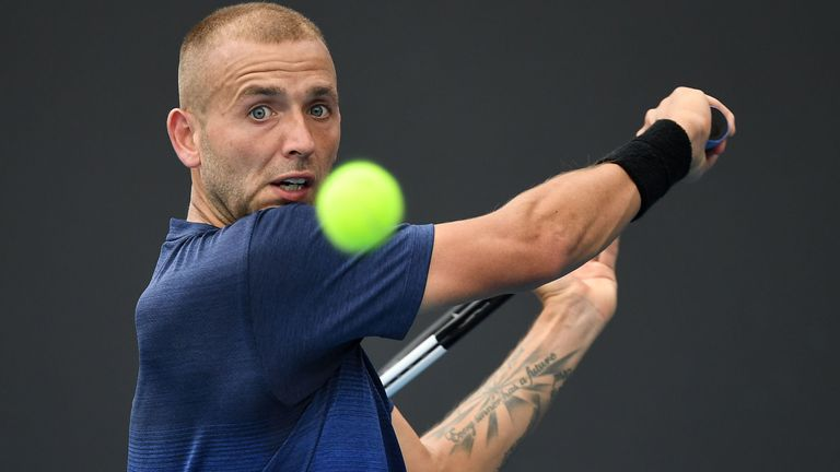 Britain's Dan Evans hits a return against Japan's Yoshihito Nishioka during their men's singles match on day three of the Australian Open tennis tournament in Melbourne on January 22, 2020.