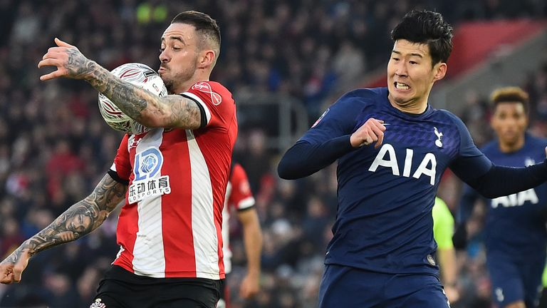 Danny Ings (L) controls the ball in front of Heung-Min Son